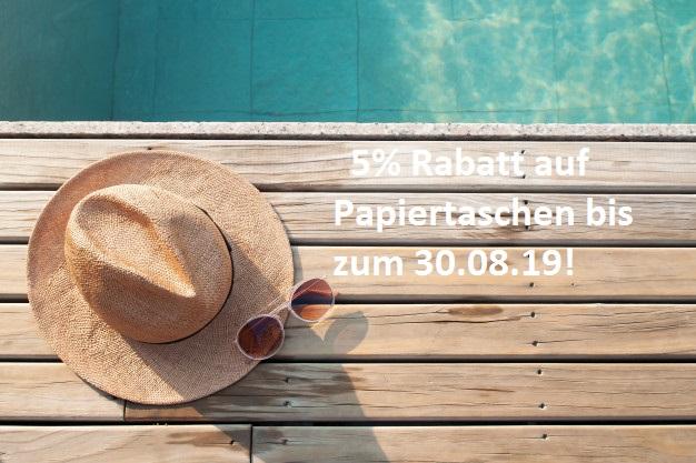 top-view-poolside-sun-hat-sunglasses-wooden-floor_1428-2653